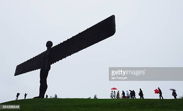 Shadow Foreign Secretary Hilary Benn MP is followed by supporters as he visits the Angel of the North sculpture with the Labour In for Britain battle...