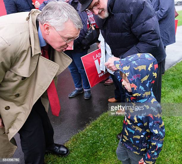 Shadow Foreign Secretary Hilary Benn MP speaks to a young boy as he visits the Angel of the North with the Labour In for Britain battle bus on May 26...