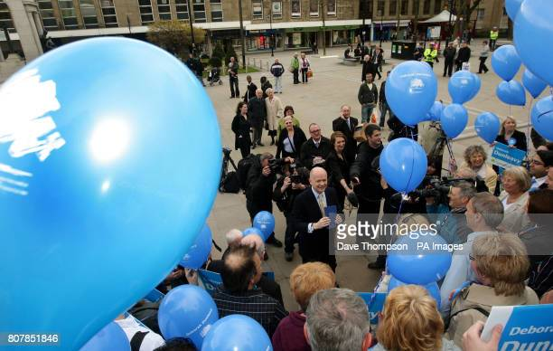 Shadow Foreign Secretary William Hague holds the party's manifesto as he talks to Conservative Party supporters on the steps of Bolton Town Hall...