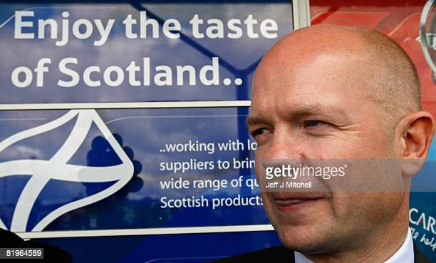 Shadow Foreign Secretary William Hague licks his lips during a visit to Tesco in Shettleston as he supports Davina Rankin the Conservative Party...