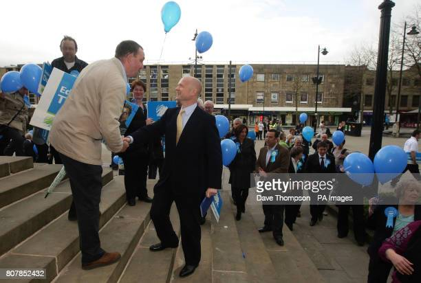 Shadow Foreign Secretary William Hague meets a member of the public on the steps of the town hall during a visit to Bolton where he delivered the...