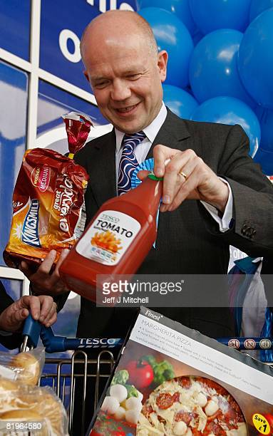 Shadow Foreign Secretary William Hague smiles during a visit to Tesco in Shettleston as he supports Davina Rankin the Conservative Party candidate in...