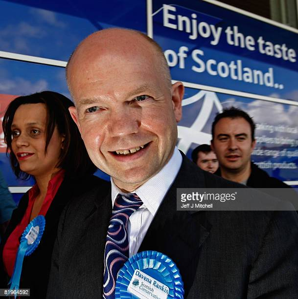 Shadow Foreign Secretary William Hague stands with Davina Rankin the Conservative Party candidate in the Glasgow East byelection on a visit to Tesco...