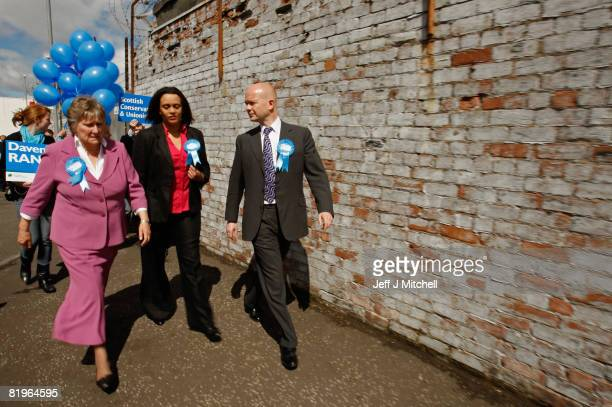 Shadow Foreign Secretary William Hague walks with Davina Rankin the Conservative Party candidate in the Glasgow East byelection on a visit to Tesco...