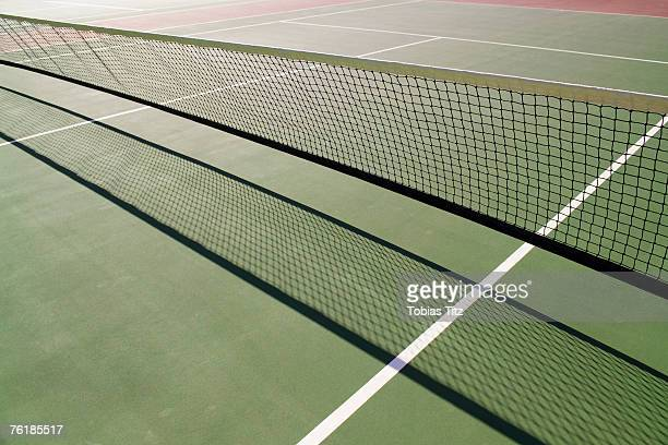 Shadow from a tennis net on a tennis court