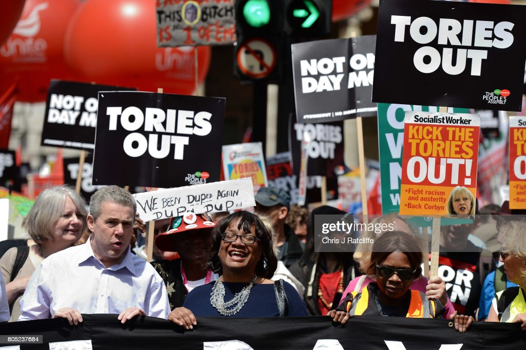 Shadow Home Secretary, Diane Abbott (2L) leads the 'Not One Day More' march at BBC Broadcasting House on July 1, 2017 in London, England. Thousands of protesters joined the anti-Tory demonstration at BBC Broadcasting House and marched to Parliament Square. The demonstrators were calling for an end to the Conservative Government and policies of austerity.