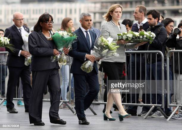 Shadow Home Secretary Diane Abbott Mayor of London Sadiq Khan and Home Secretary Amber Rudd take part in a vigil for the victims of the London Bridge...