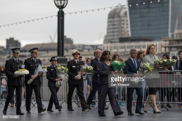 Shadow Home Secretary Diane Abbott Mayor of London Sadiq Khan and Home Secretary Amber Rudd arrive to lay flowers an take part in a vigil for the...
