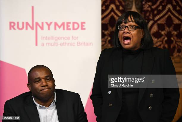 Shadow Home Secretary Diane Abbott speaks during a meeting with representatives of the Windrush generation as Labour MP David Lammy looks on at the...