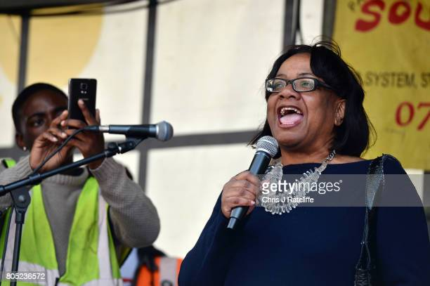 Shadow Home Secretary Diane Abbott speaks to demonstrators during the 'Not One Day More' march at BBC Broadcasting House on July 1 2017 in London...