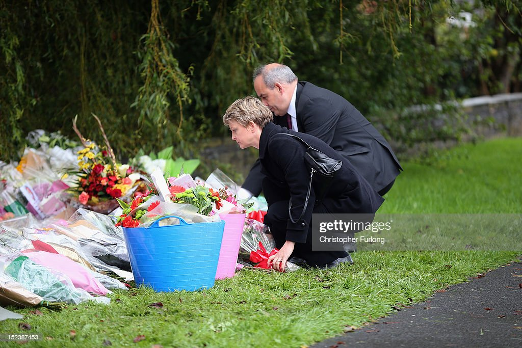 Shadow Home Secretary Yvette Cooper and Shadow Policing Minister David Hanson lay flowers at the scene of the shooting of WPCs Nicola Hughes and Fiona Bone in Hattersley on September 20, 2012 in Manchester, England. Local man Dale Cregan, 29, has been arrested in connection with the shooting of WPCs Nicola Hughes and Fiona Bone, who suffered fatal injuries in a gun and grenade attack in Mottram, during a routine call to investigate a burglary, in Abbey Gardens on Tuesday.