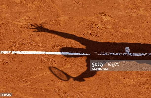 A shadow is cast on court as a player is about to serve during the ATP Tennis Masters Series held in Monte Carlo Monaco on April 21 2002