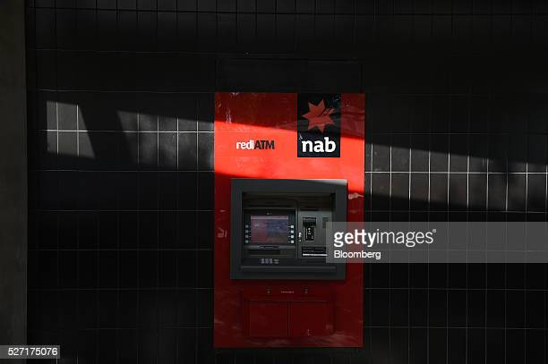 A shadow is cast over an automated teller machine at a National Australia Bank Ltd branch in Melbourne Australia on Monday May 2 2016 National...