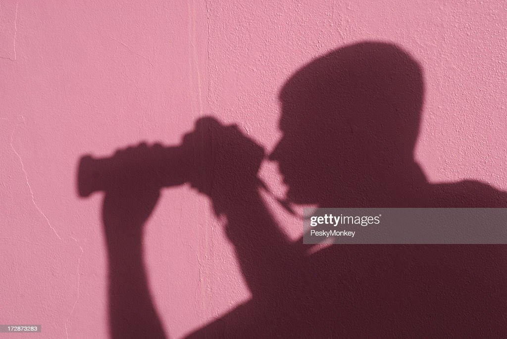 Shadow Man Photographer with Zoom Lens Pink Background : Stock Photo