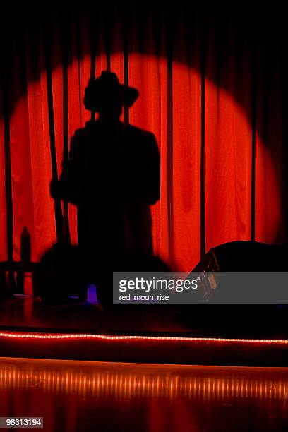shadow man (xl) - shadow puppeteer stock photos and pictures