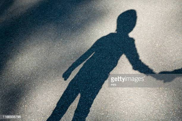 shadow of a boy - kidnapping stock pictures, royalty-free photos & images
