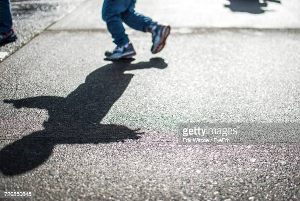 Shadow Of A Child On Street