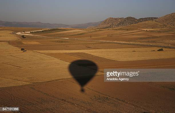 Shadow of a hot air balloon is seen in Burdur southwestern province of Turkey on July 13 2016 Burdur one of the provinces in which you can engage in...