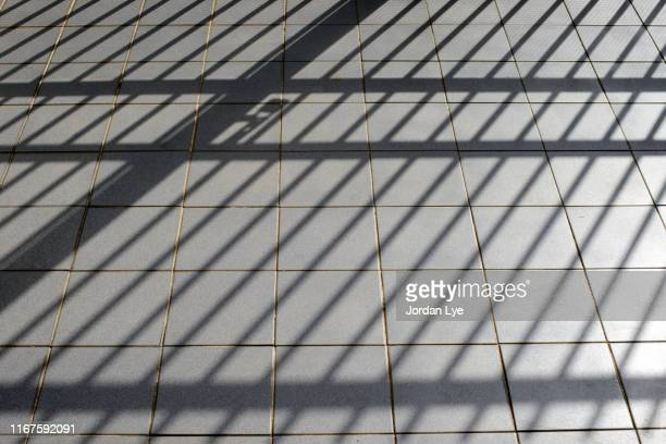 shadow of a iron gate - prison bars stock pictures, royalty-free photos & images