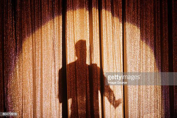 shadow of a person on a stage curtain - actor stock pictures, royalty-free photos & images