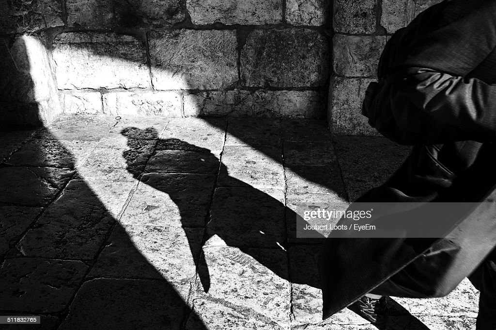 Shadow of a person wearing coat : Stock Photo