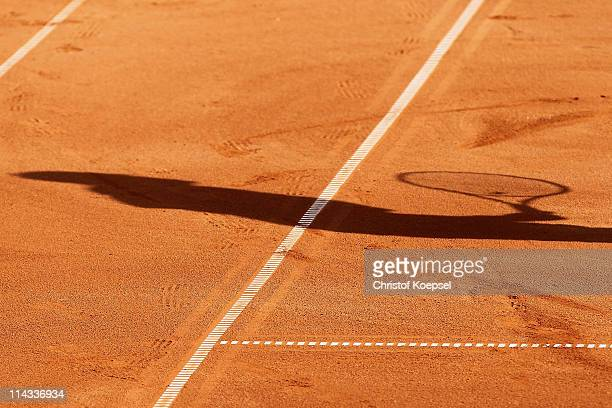 A shadow of a player is seen during the match between Philipp Petzschner and Christopher Kas and Marcel Granollers and Marc Lopez of Spain in the...