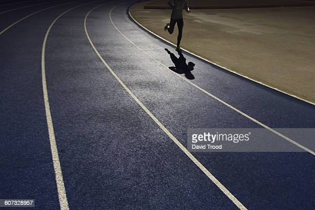Shadow of a runner on a running track