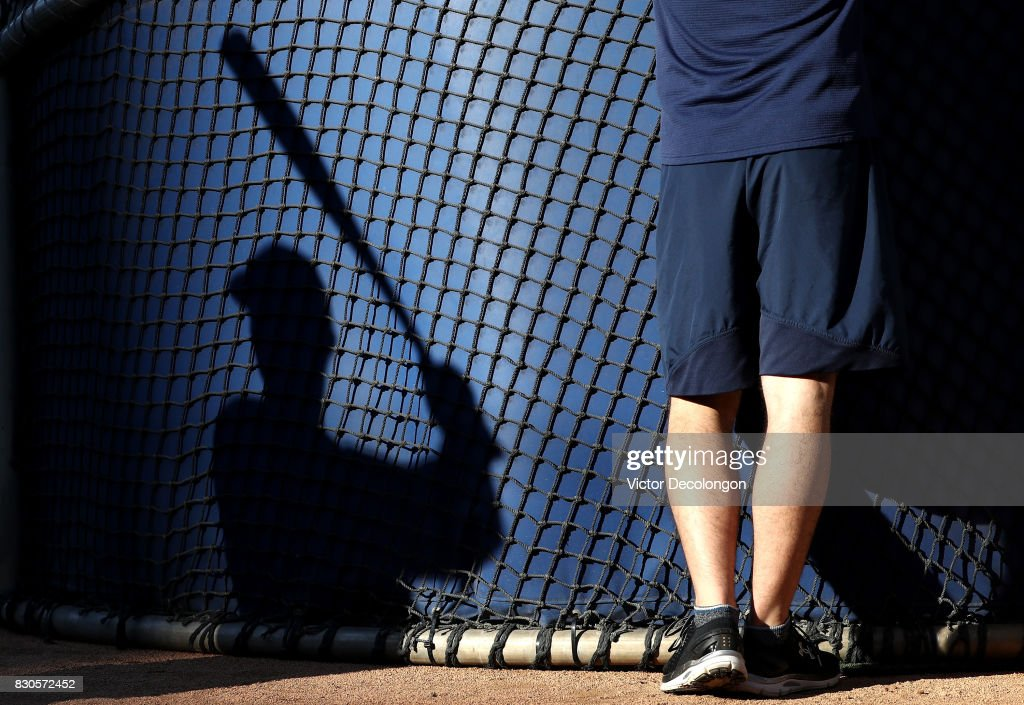 A shadow of a San Diego Padres player practicing his swing is seen on the back of the batting cage prior to the MLB game between the San Diego Padres and the Los Angeles Dodgers at Dodger Stadium on August 11, 2017 in Los Angeles, California.