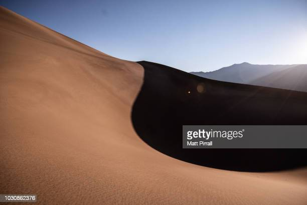shadow of a sand dune in the desert at dawn - great sand dunes national park stock pictures, royalty-free photos & images