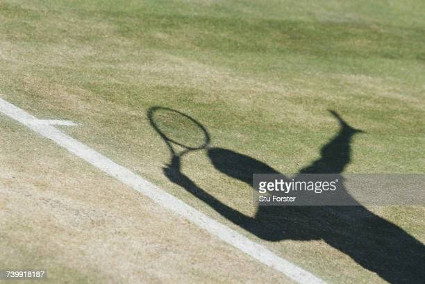 Shadow of a serve at a Men's Singles match during the Wimbledon Lawn Tennis Championships on 3 July 1997 at the All England Lawn Tennis and Croquet...