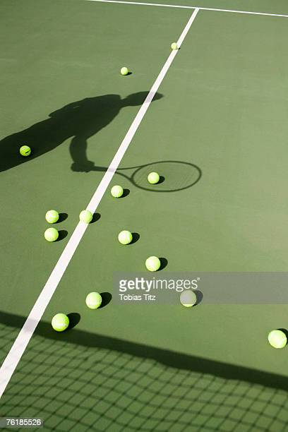 Shadow of a tennis player on the court