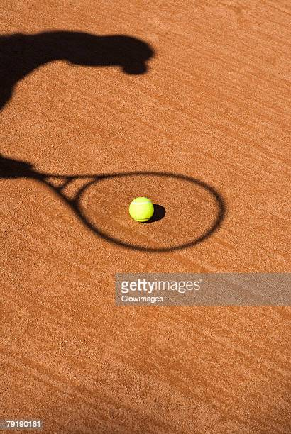 Shadow of a tennis racket on a tennis ball