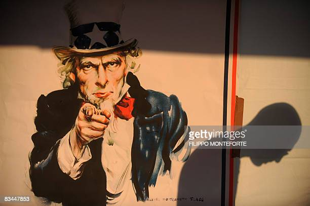 A shadow of a voter is seen on a poster of Uncle Sam reading 'Come to vote in California' during the 'American elections for non Americans' in the...
