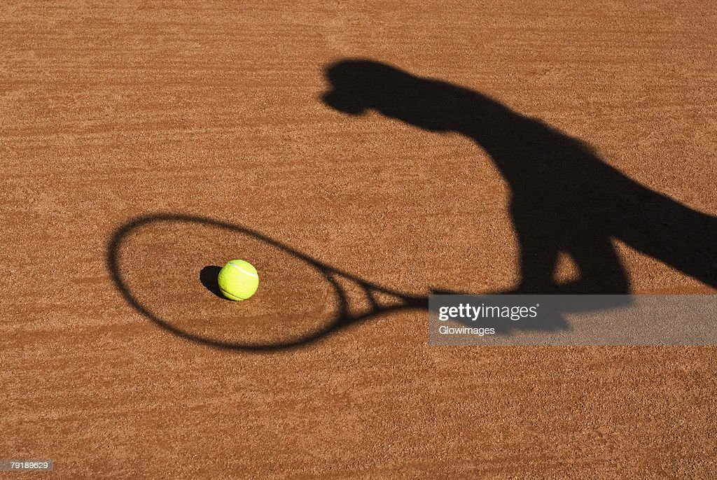 Shadow of a woman playing tennis : Foto de stock