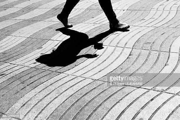 Shadow of a young woman walking in the street in Barcelona