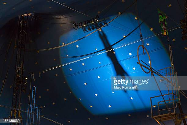 shadow of acrobat in spotlight on wall - circus stock pictures, royalty-free photos & images