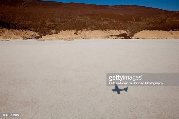 shadow of aeroplane over lake assal, djibouti, africa - djibouti stockfoto's en -beelden