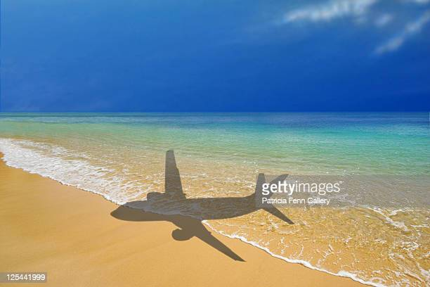 Shadow of air travel on sand and beach