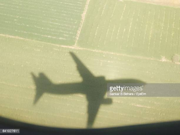 Shadow Of Airplane On Field