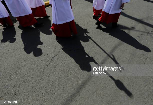 Shadow of altar boys is seen outside San Jeronimo Church during celebrations of San Jeronimo the patron saint of Masaya in Masaya some 30 km from...