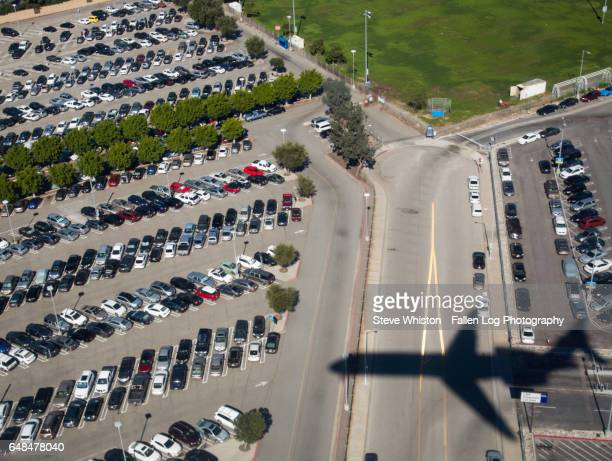 Shadow of an aiplane on a parking lot