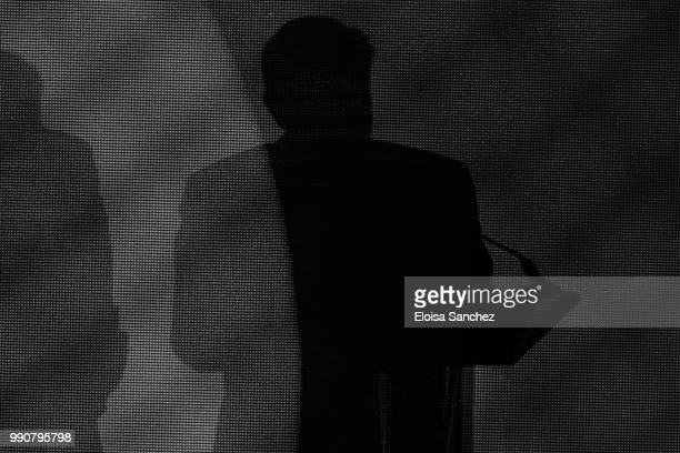 Shadow of Andres Manuel Lopez Obrador while giving a speech for his virtual victory for the presidency of Mexico at his party media centre as part of...