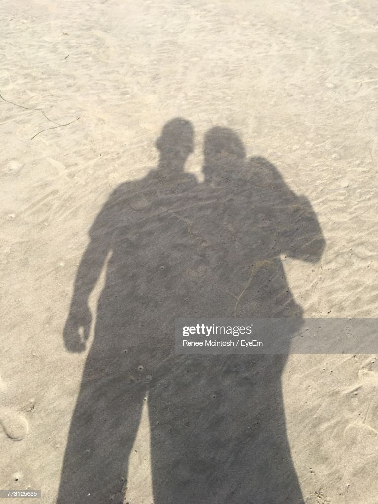 Shadow Of Couple On Sand At Beach : Stock Photo