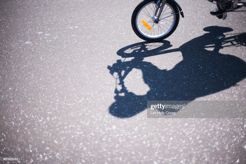 Shadow of cyclist on road : Stock Photo
