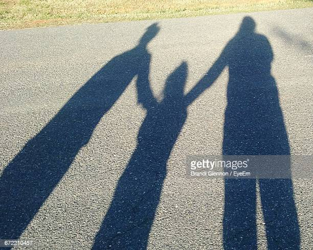 Shadow Of Family On Road