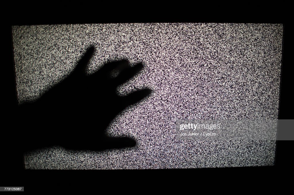 Shadow Of Hand On Television Screen : Photo