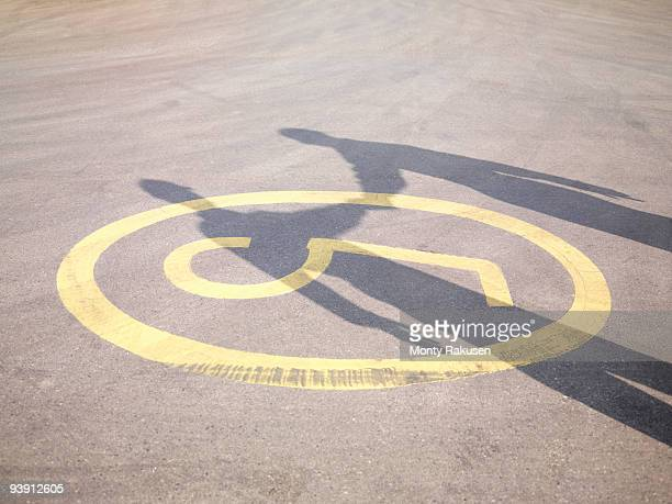 shadow of handshake on tarmac - monty shadow stock photos and pictures