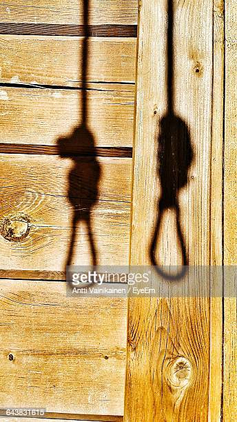 shadow of hanging gallows on wooden wall - hanging gallows stock pictures, royalty-free photos & images