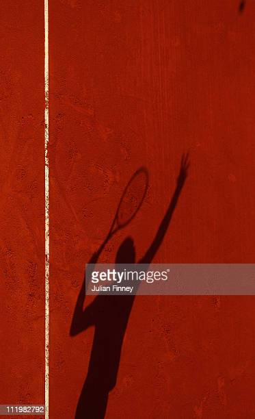 A shadow of Jo Wilfried Tsonga of France serving in his match against Juan Monaco of Argentina during Day Two of the ATP Masters Series Tennis at the...
