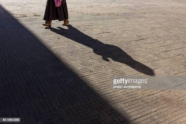 shadow of ladakhi prayer - foot worship stock pictures, royalty-free photos & images